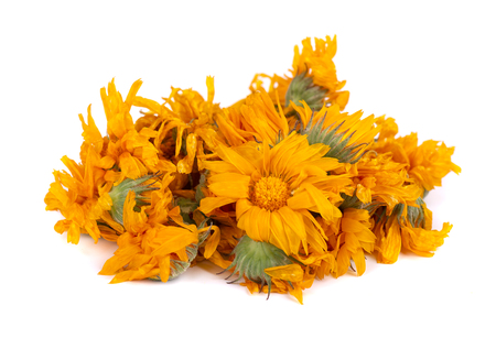 Dried calendula flowers isolated on white background.
