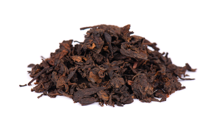 Chinese tea Shou Puer. Pressed fermented Pu-erh tea. Macro close up. Aromatic black puer tea. Healthy drink.