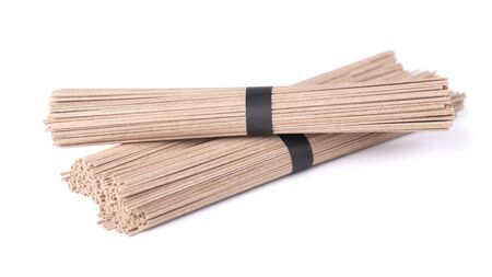 Soba noodles, isolated on white background. Bundle of buckwheat japanese soba noodle sticks. Asian food