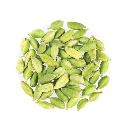 Cardamom pods isolated on white background. Green cardamon seeds. Clipping path. Top view
