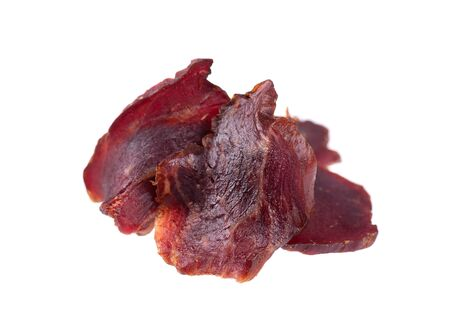 Beef jerky isolated on white background. Pieces of dry meat. Close-up. Clipping path
