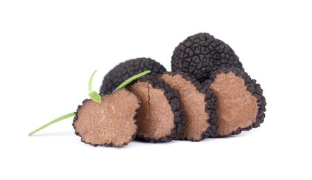Black truffles isolated on a white background. Fresh sliced truffle. Delicacy exclusive truffle mushroom. Piquant and fragrant French delicacy. Clipping path