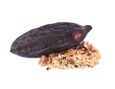 Tonka beans isolated on white background. Bean of Dipteryx odorata, cumaru or kumaru. Fresh aroma tonka bean powder. Close-up Stock Photo
