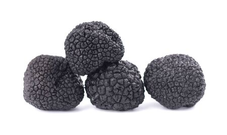 Black truffles isolated on a white background. Delicacy exclusive truffle mushroom. Piquant and fragrant French delicacy. 写真素材