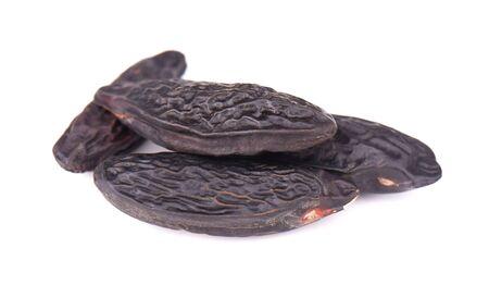 Tonka beans isolated on white background. Bean of Dipteryx odorata, cumaru or kumaru. Fresh aroma tonka beans Stock Photo