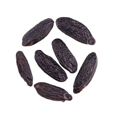 Tonka beans isolated on white background. Bean of Dipteryx odorata, cumaru or kumaru. Fresh aroma tonka beans. Close-up. Top view