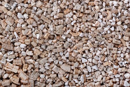 Vermiculite background. Exfoliated perlite and vermiculite texture background. Mineral used in gardening