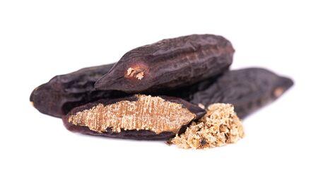 Tonka beans isolated on white background. Bean of Dipteryx odorata, cumaru or kumaru. Fresh aroma tonka bean powder. Close-up Stok Fotoğraf