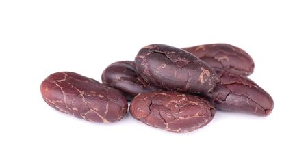 Peeled cacao beans, isolated on white background. Roasted and aromatic cocoa beans, natural chocolate Stok Fotoğraf