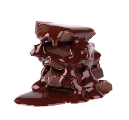Chocolate pieces stack and chocolate syrup isolated on white background. Close up