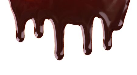 Chocolate streams isolated on white background. Chocolate syrup, topping, dark chocolate Stok Fotoğraf