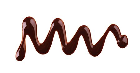 Chocolate syrup drizzle isolated on white background. Splashes of sweet chocolate sauce. Top view Stok Fotoğraf