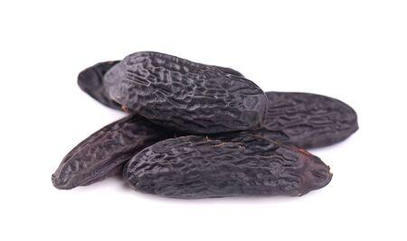 Tonka beans isolated on white background. Bean of Dipteryx odorata, cumaru or kumaru. Fresh aroma tonka beans Stok Fotoğraf