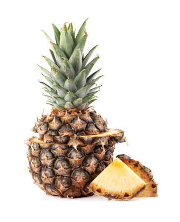 Pineapple isolated. One whole pineapple with green leaves isolated on white background Фото со стока