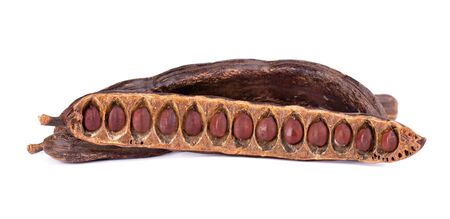 Ripe carob pods and bean isolated on white background. 版權商用圖片