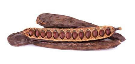 Ripe carob pods and bean isolated on white background