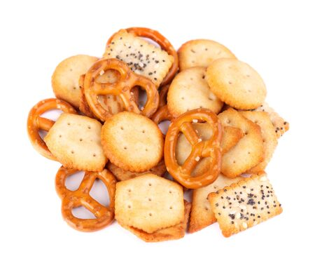 Mix crackers isolated on white background. Dry cracker cookies isolated. Salty snacks isolated. Top view Stock Photo