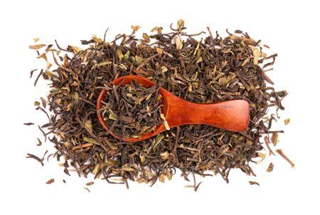 Black tea Darjeeling, isolated on white background. Organic tea. Top view. Close up