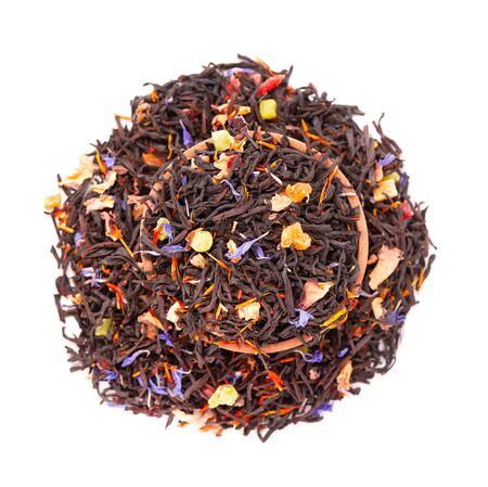 Black Ceylon tea with candied fruit, saffron, rose and cornflower petals, isolated on white background. Organic tea. Top view. Close up