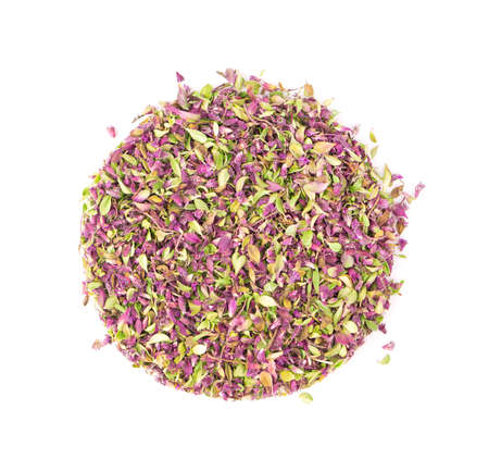 Dried thyme flowers, isolated on white background. Natural herbs - thyme. Organic tea. Top view. Close up.