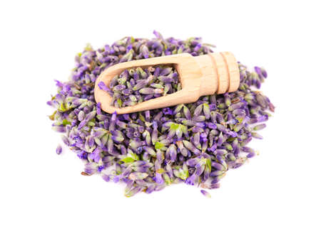 Lavender flowers on a wooden spoon, isolated on white background. Petals of lavender flowers. Medicinal herbs Archivio Fotografico