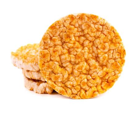Caramelized rice-corn crispbread, isolated on white background. Sweet puffed whole grain crispbread