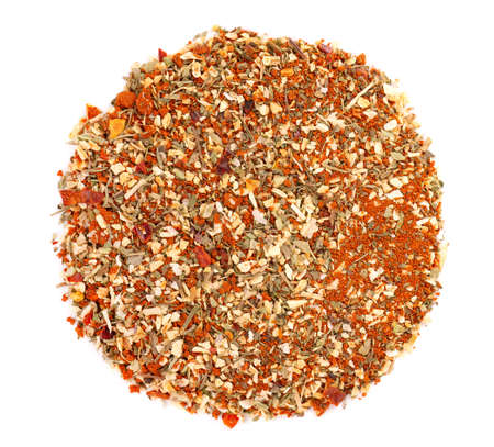 Mix of herbs, spices and dry tomatoes, isolated on white background. Natural organic food seasoning. Top view
