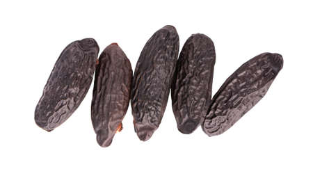 Tonka beans isolated on white background. Bean of Dipteryx odorata, cumaru or kumaru. Fresh aroma tonka beans. Close-up. Top view