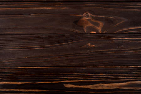 Wood texture. Surface of teak dark wood background for design and decoration