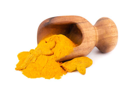 Dry turmeric powder in wooden scoop, isolated on white background. Curcuma longa linn.
