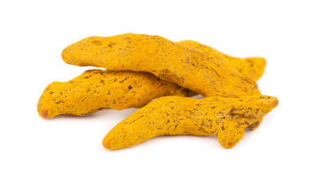 Dry turmeric root isolated on white background. Curcuma longa linn.