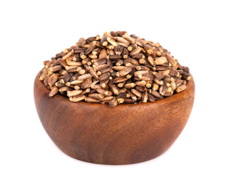 Milk Thistle seed in wooden bowl, isolated on white background.