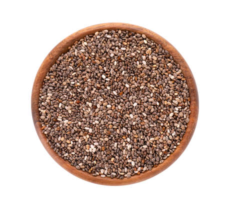 Chia seeds in wooden bowl, isolated on white background. Healthy superfood. Closeup macro of organic chia seeds. Top view.