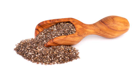 Chia seeds in wooden scoop, isolated on white background. Healthy superfood. Organic chia seeds. Banco de Imagens