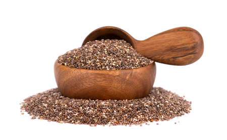 Chia seeds in wooden bowl and spoon, isolated on white background. Organic chia seeds.