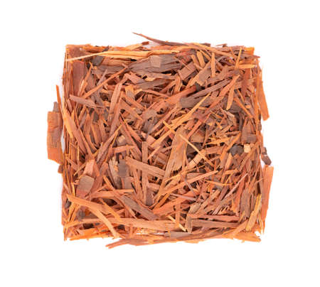 Lapacho herbal tea, isolated on white background. Natural Taheeboo dry tea. Pau darco herb. Tabebuia heptophylla. Top view.
