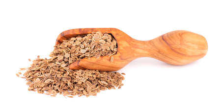 Dill seeds in wooden scoop, isolated on white background. Natural dry dill seeds. Anethum graveolens. 版權商用圖片