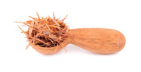 Lapacho herbal tea in wooden spoon, isolated on white background. Natural Taheeboo dry tea. Pau darco herb. Tabebuia heptophylla.