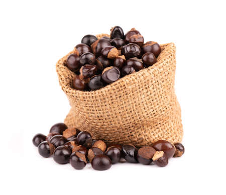 Guarana seed in bag, isolated on white background. Dietary supplement guarana, caffeine cource for energy drinks.