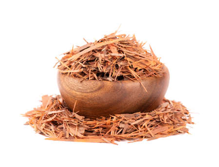 Lapacho herbal tea in wooden bowl, isolated on white background. Natural Taheeboo dry tea. Pau darco herb. Tabebuia heptophylla.