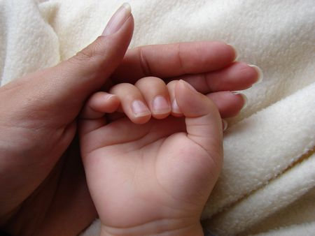 palmistry: Mommy and Babys Hand Stock Photo