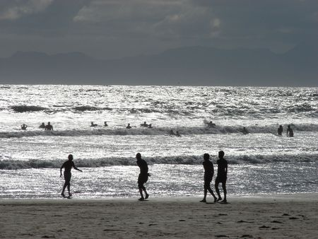Silvery seas with holiday makers Imagens