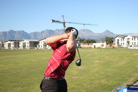 driving range: Young golfer practising on the driving range Stock Photo