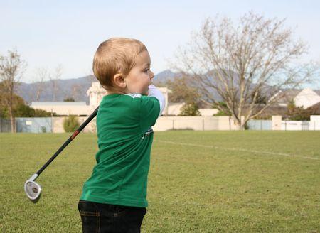 driving range: Toddler practising golf on the driving range