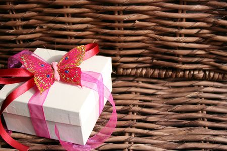 Butterfly Gift Box to the side of a wooden fixture photo