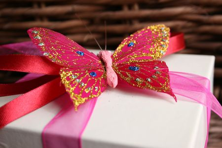 Close up of a butterfly as a decoration on a gift box photo