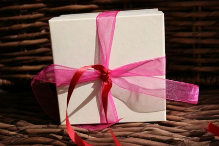 Gift box with ribbon tied in a knot photo