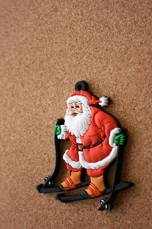 skying: Santa Clause on a cork background Stock Photo
