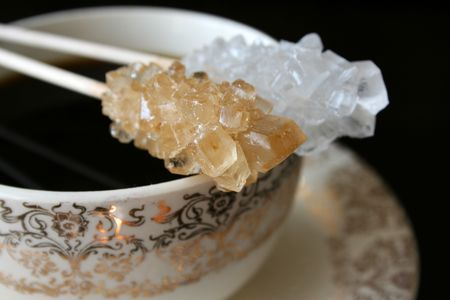 Antique tea cup with sugar crystals on sticks