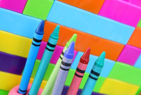 kiddies: Kiddies Crayons proped upright in balls of clay against building blocks in the background Stock Photo
